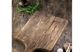 empty wooden cutting board on kitchen table